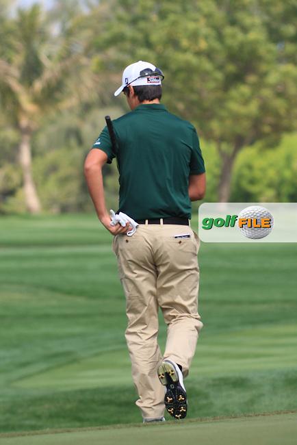 Matteo Manassero (ITA) making his way onto the 4th green.on day one of the Omega Dubai Desert Classic 2011 on the Majlis Course, Emirates Golf Club, Dubai, UAE. 10/02/2011.Picture Fran Caffrey/www.golffile.ie.