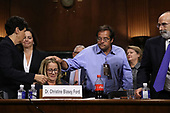 WASHINGTON, DC - SEPTEMBER 27:  A man pats Christine Blasey Ford on the head at the conclusion of her testimony before the Senate Judiciary Committee in the Dirksen Senate Office Building on Capitol Hill September 27, 2018 in Washington, DC. A professor at Palo Alto University and a research psychologist at the Stanford University School of Medicine, Ford has accused Supreme Court nominee Judge Brett Kavanaugh of sexually assaulting her during a party in 1982 when they were high school students in suburban Maryland.  (Photo by Win McNamee/Getty Images)