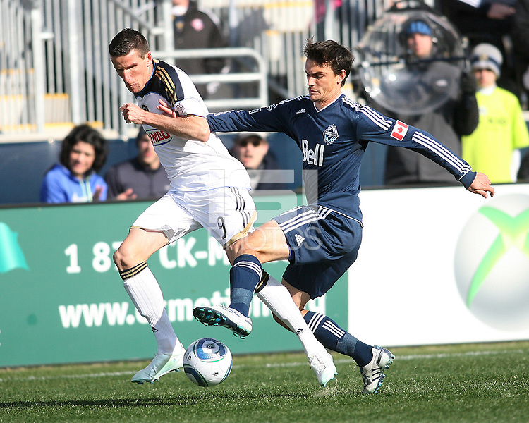 Sebastian Le Toux#9 of the Philadelphia Union goes for the ball against Alain Rochat#4 of the Vancouver Whitecaps during an MLS match at PPL Park in Chester, PA. on March 26 2011. Union won 1-0.