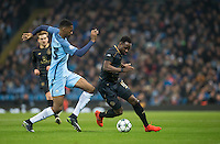 Tosin Adarabioyo of Manchester City races in on Moussa Dembele of Celtic during the UEFA Champions League GROUP match between Manchester City and Celtic at the Etihad Stadium, Manchester, England on 6 December 2016. Photo by Andy Rowland.