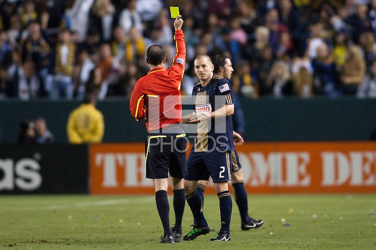 Referee Paul Ward gives Philadelphia Union defender Jordan Harvey (2) a red card. The LA Galaxy defeated the Philadelphia Union 1-0 at Home Depot Center stadium in Carson, California on  April  2, 2011....