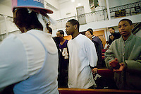 New York, USA - Teenagers attend mass at the Greater Hood Memorial AME Zion Church, home of the Hip-Hop Church, in Harlem, New York, USA, 17 February 2005. Photo Credit: David Brabyn.