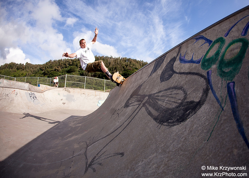 Caucasian male skateboarding at Banzai Skatepark on the North Shore of Oahu, Hawaii