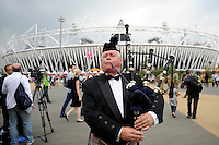 27.07.2012. London England.  A man plays bagpipe in the Olympic Park prior the Opening Ceremony of the London 2012 Olympic Games, London, Britain, 27 July 2012.