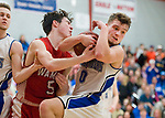 WOLCOTT, CT-031418JS12- Wamogo's Reid Turtoro (5) and East Hampton's Thomas Close (0) battle for a rebound during their Division V semifinal game Wednesday at Wolcott High School. <br /> Jim Shannon Republican-American