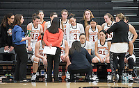 Anahit Aladzhanyan, head women's basketball coach, talks with the team. The Occidental College women's basketball team plays against Chapman University in Rush Gym on Jan. 7, 2015. (Photo by Marc Campos, Occidental College Photographer)