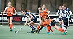 Den Haag - Hoofdklasse hockey dames, HDM-GRONINGEN  (6-2).  Fay van der Elst (HDM) passeert Anouk van den Berg (Gron.)  COPYRIGHT KOEN SUYK