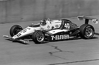 BROOKLYN, MI - SEPTEMBER 22: Emerson Fittipaldi drives a Pat Patrick  March 85C/Cosworth during the Detroit News 200 CART Indy Car race at the Michigan International Speedway near Brooklyn, Michigan, on September 22, 1985.
