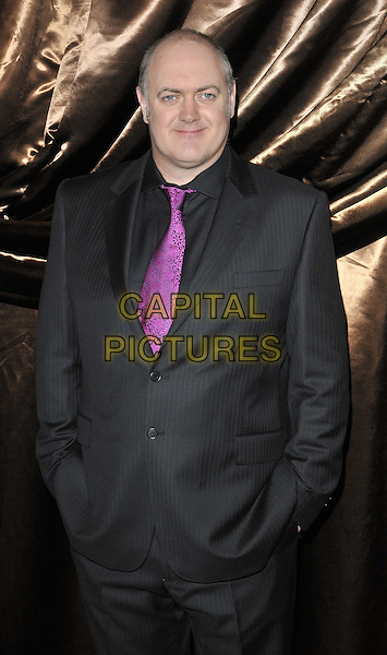 Dara O'Briain .The Galaxy National Book Awards 2011, Mandarin Oriental Hyde Park hotel, Knightsbridge, London, England..November 5th, 2011.half length black suit purple pink shirt tie hands in pockets .CAP/CAN.©Can Nguyen/Capital Pictures.