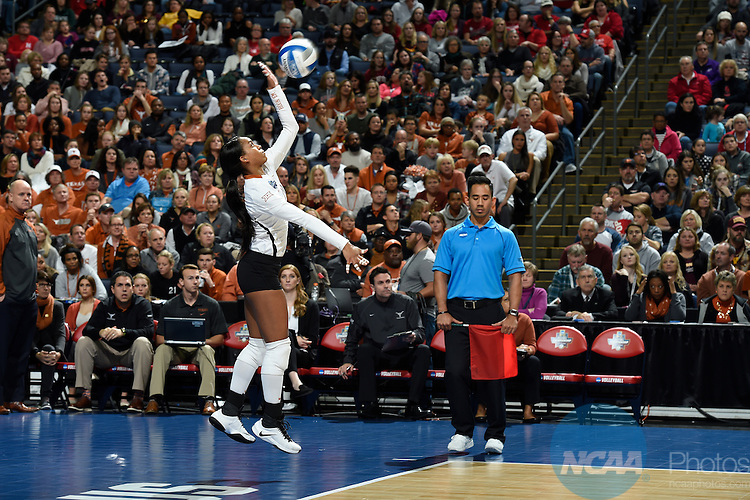COLUMBUS, OH - DECEMBER 17:  Chloe Collins (21) of the University of Texas serves against Stanford University during the Division I Women's Volleyball Championship held at Nationwide Arena on December 17, 2016 in Columbus, Ohio.  Stanford defeated Texas 3-1 to win the national title. (Photo by Jamie Schwaberow/NCAA Photos via Getty Images)