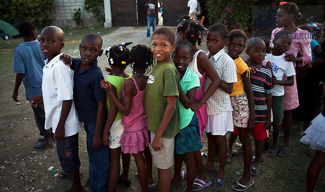 Children line up in the courtyard of the Notre Dame facility in Leogane, Haiti...Photo by Matt Cashore/University of Notre Dame