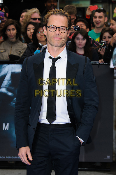 Guy Pearce.'Prometheus' film premiere held at the Empire Leicester Square, .London, England , UK, 31st May 2012..half length suit tie glasses black navy blue white shirt .CAP/CJ.©Chris Joseph/Capital Pictures.