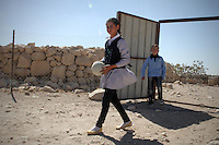 """12-year-old Nawal Jabarin's  village, Jinba, in the South Hebron Hills in the West Bank, is inside an area designated in the 1980s by the Israeli army as """"Firing Zone 918"""" for military training. The army wants to clear out eight Palestinian communities on the grounds that it is unsafe for them to remain within a military training zone and they are not """"permanent residents"""". Nawal Jabarin and her family live in a cave. Her school, a basic three-room structure, is under a demolition order, as is the only other building in the village, the mosque, which is used as an overspill classroom. Both were constructed without official Israeli permits, which are impossible to secure. Haytham Abu Sabha, Nawal's teacher, says his pupils' lives are """"very hard. The children have no recreation. They lack the basic things in life – there is no electricity, no playgrounds, high malnutrition. When they get sick or are hurt, it's hard getting them to hospital""""."""