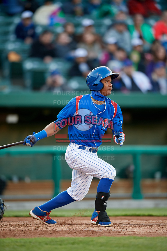 South Bend Cubs second baseman Yeiler Peguero (20) follows through on a swing during a game against the Clinton LumberKings on May 5, 2017 at Four Winds Field in South Bend, Indiana.  South Bend defeated Clinton 7-6 in nineteen innings.  (Mike Janes/Four Seam Images)