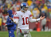 Landover, MD - November 30, 2008 -- New York Giants quarterback Eli Manning (10) looks questioningly towards the sideline late in the second quarter against the Washington Redskins at FedEx Field in Landover, Maryland on Sunday, November 30, 2008..Credit: Ron Sachs / CNP.(RESTRICTION: No New York Metro or other Newspapers within a 75 mile radius of New York City)