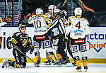 Stockholm 2013-12-07 Ishockey Elitserien AIK - Skellefte&aring; AIK :  <br /> Skellefte&aring;s Jimmie Ericsson har gjort 2-0 och gratuleras av lagkamrater medan AIK:s Derek Joslin deppar framf&ouml;r<br /> (Foto: Kenta J&ouml;nsson) Nyckelord:  AIK Skellefte&aring; SAIK jubel gl&auml;dje lycka glad happy depp besviken besvikelse sorg ledsen deppig nedst&auml;md uppgiven sad disappointment disappointed dejected