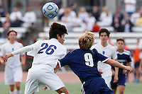 Mishawaka Marian's Francisco Tavarez (26) and Providence's Alex Lancaster (9) play the ball during the IHSAA Class A Boys Soccer State Championship Game on Saturday, Oct. 29, 2016, at Carroll Stadium in Indianapolis. Marian won 4-0. Special to the Tribune/JAMES BROSHER