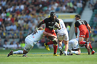 Billy Vunipola of Saracens is tackled by Tom Francis of Exeter Chiefsduring the Aviva Premiership Rugby Final between Saracens and Exeter Chiefs at Twickenham Stadium on Saturday 28th May 2016 (Photo: Rob Munro/Stewart Communications)