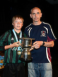 Drogheda and District Schoolboys league representative Gary Doyle presents Albion Rovers Black under 13 captain Jamie Jilkes with the Premier Divisoin cup. Photo:Colin Bell/pressphotos.ie