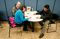 Chris Bailey (cq, left) and Michelle Bailey (cq) sign forms with salesman Eli Martinez (cq) for a new F150 Ford truck at Bankston Ford in Frisco, Texas, Thursday, Jan., 28, 2009. Ford reported gains in earnings for the first time in four years...PHOTOS/ Matt Nager