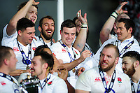 George Ford of England is all smiles on the winners' podium. RBS Six Nations match between France and England on March 19, 2016 at the Stade de France in Paris, France. Photo by: Patrick Khachfe / Onside Images