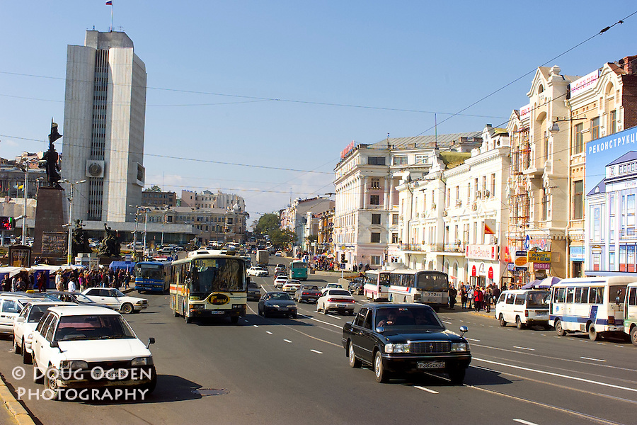 The Svetlanskaya. The longest street in Vladivostok passes in front of the Central Square with the Administrative Building in the background, Russia
