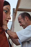"Spain. Balearic Islands. Minorca (Menorca). Mahon. The ""Festes de la Mare de Déu de Gràcia"" is a traditional summer festival. A man is adjusting the woman's headscarf before Giants' parade. Maó (in Catalan) and Mahón (in Spanish), written in English as Mahon, is a municipality, the capital city of the island of Menorca, and seat of the Island Council of Menorca. The city is located on the eastern coast of the island, which is part of the autonomous community of the Balearic. In Spain, an autonomous community is a first-level political and administrative division, created in accordance with the Spanish constitution of 1978, with the aim of guaranteeing limited autonomy of the nationalities and regions that make up Spain. 8.09.2019 © 2019 Didier Ruef"