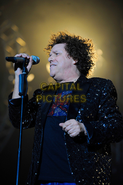 Leo Sayer.Performing live in concert as part of the Once In A Lifetime Tour, Wembley Arena, London, England, England..11th November 2012.on stage in concert live gig performance performing music half length black top suit jacket  shiny singing profile .CAP/MAR.© Martin Harris/Capital Pictures.