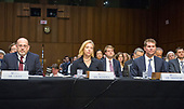 From left to right: Dr. Samuel Liles, Acting Director of Cyber Division, Office of Intelligence and Analysis, United States Department of Homeland Security; Jeanette Manfra, Acting Director of Undersecretary, National Protection and Programs Directorate, US Department of Homeland Security; and Bill Priestap, Assistant Director of Counterintelligence Division, US Federal Bureau of Investigation listen to the opening statements of the Chair and Ranking Member of the US Senate Select Committee on Intelligence on the Russian intervention in the 2016 Presidential election on Capitol Hill in Washington, DC on Wednesday, June 21, 2017.<br /> Credit: Ron Sachs / CNP
