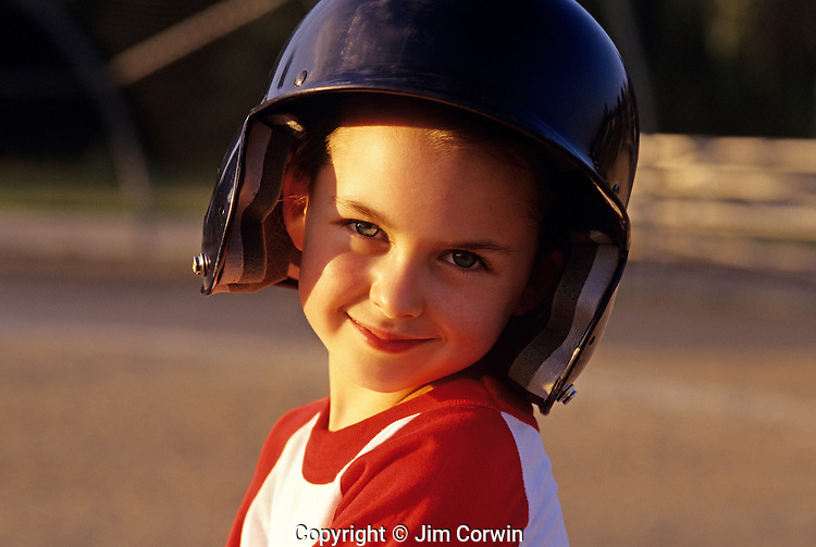 Young girl Little League Baseball player sunset light portrait
