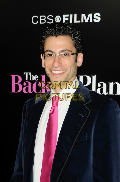 "ADAM TSEKHMAN.arriving at the premiere of CBS Films' ""The Back-up Plan"" at the Regency Village Theatre in Westwood, California, USA, April 21st 2010..arrivals portrait headshot pink tie glasses blue velvet jacket white shirt smiling .CAP/ROT.©Lee Roth/Capital Pictures"