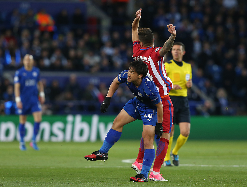 Leicester City's Shinji Okazaki and Atletico Madrid's Jose Gimenez<br /> <br /> Photographer Stephen White/CameraSport<br /> <br /> UEFA Champions League Quarter Final Second Leg - Leicester City v Atletico Madrid - Tuesday 18th April 2017 - King Power Stadium - Leicester <br />  <br /> World Copyright &copy; 2017 CameraSport. All rights reserved. 43 Linden Ave. Countesthorpe. Leicester. England. LE8 5PG - Tel: +44 (0) 116 277 4147 - admin@camerasport.com - www.camerasport.com