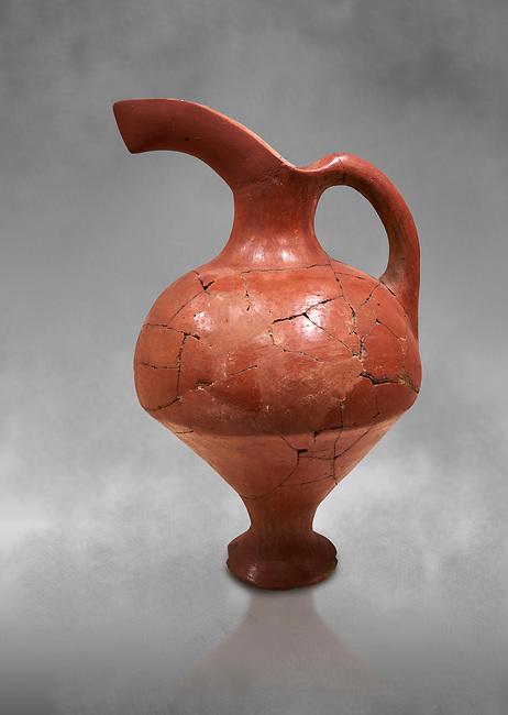Hittite terra cotta red glazed beak spout pitcher . Hittite Period, 1600 - 1200 BC. Çorum Archaeological Museum, Corum, Turkey. Against a grey bacground.
