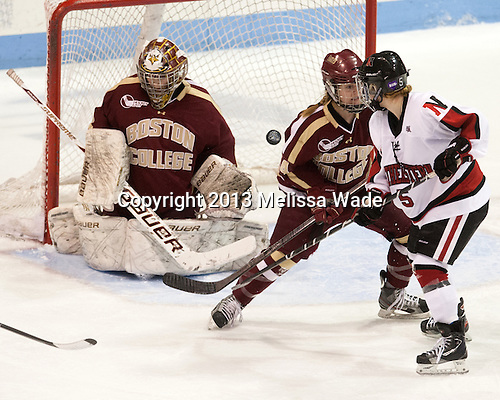 Corinne Boyles (BC - 29), Emily Pfalzer (BC - 14), Kelly Wallace (NU - 5) - The Northeastern University Huskies defeated Boston College Eagles 4-3 to repeat as Beanpot champions on Tuesday, February 12, 2013, at Matthews Arena in Boston, Massachusetts.