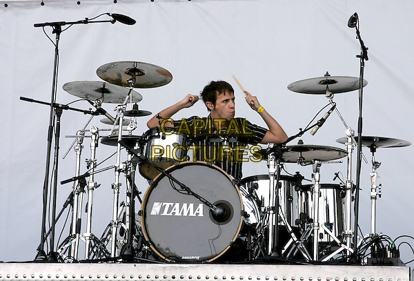 MUSE.The KROQ Miller Lite Inland Invasion 4 held at The Hyundai Pavilion at Glen Helen Devore, California .September 18, 2004.stage, concert, music, live, gig, drums.www.capitalpictures.com.sales@capitalpictures.com.Copyright by Debbie VanStory