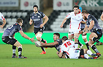 Ospreys scrum half Rhys Webb gets his pass away to Dan Biggar as Ulster fullback Louis Ludik makes the tackle.<br /> Guiness Pro12<br /> Ospreys v Ulster<br /> 20.12.14<br /> ©Steve Pope -SPORTINGWALES