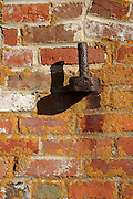 Rusted door hinge at Fort Constitution . Located in New Castle, New Hampshire USA which is part of the New England seacoast.  ..Portsmouth Harbor Light is located in the Fort