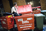 © Joel Goodman - 07973 332324 . FILE PICTURE DATED 05/05/2013 of a night time worker sitting in a wheelie bin smoking a cigarette overnight , as the British Home Secretary , Theresa May , takes questions at the annual Police Federation conference on licensing and policing the night time economy , today (Wednesday 15th May 2013) . Photo credit : Joel Goodman