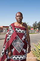 Africa, Swaziland, Malkerns. Man on his way from church on Sunday.