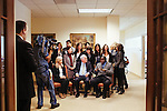 Ted Turner poses for a group portrait with CNN Journalism Fellows, who are from all over the world, in his building in downtown Atlanta October 23, 2013.