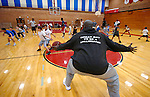 Williamsport High School Head Coach Allen Taylor leads young players through a drill during Little Millionaires basketball practice at the school gym Tuesday, Oct. 26, 2010.