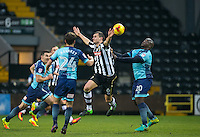 Adebayo Akinfenwa of Wycombe Wanderers battles Haydn Hollis of Notts Co during the Sky Bet League 2 match between Notts County and Wycombe Wanderers at Meadow Lane, Nottingham, England on 10 December 2016. Photo by Andy Rowland.