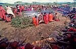 Maasai Moran gather to eat meat as part of the initiation into manhood of the Moran.<br />Kajiado, Kenya.