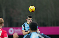 Luke O'Nien of Wycombe Wanderers wins the ball in the air during the Sky Bet League 2 match between Wycombe Wanderers and Crawley Town at Adams Park, High Wycombe, England on 28 December 2015. Photo by Andy Rowland / PRiME Media Images