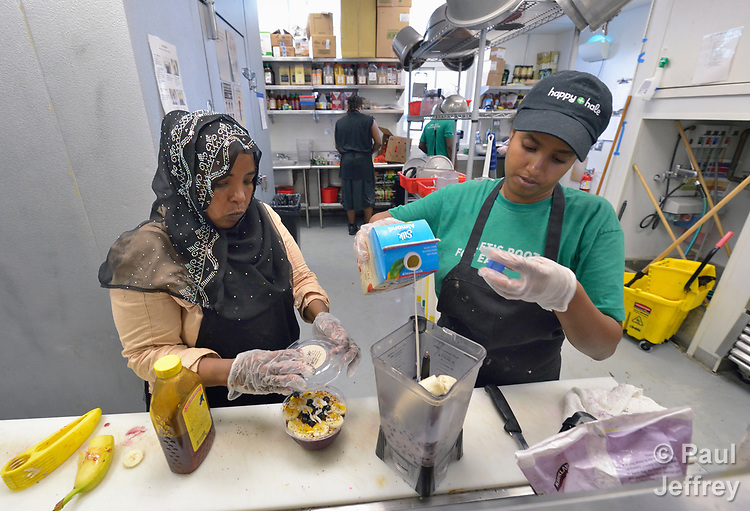 Sabah Mohamed (left), a refugee from Somalia, and Senait Araya, a refugee from Eritrea, work in a restaurant in Durham, North Carolina, where they were resettled with assistance from Church World Service.<br /> <br /> Photo by Paul Jeffrey for Church World Service.
