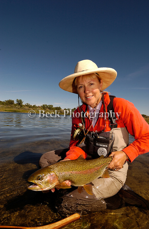 Cathy Beck with a nice rainbow on the Bighorn River in Montana