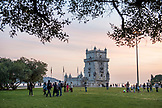 PORTUGAL, Lisbon, The Belem Tower at Dusk and people at the park nearby