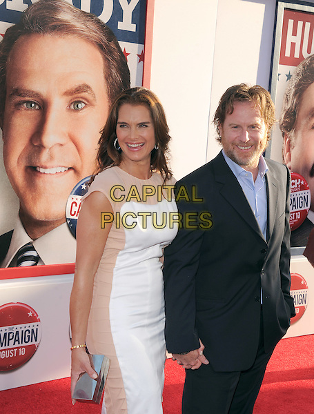 Brooke Shields and Chris Henchy.Premiere of 'The Campaign' held at The Grauman's Chinese Theatre in Hollywood, California, USA..August 2nd, 2012 .half length dress black suit blue shirt married husband wife  clutch bag white sheer silver  beige holding hands beard facial hair .CAP/RKE/DVS.©DVS/RockinExposures/Capital Pictures.