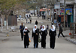 Girls walk home from school in the Nuseirat refugee camp in the middle of the Gaza strip. .