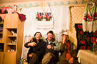 ROMANIA / Maramures / Mara / 18.10.2006 ..Inebriated men enjoying an evening. Now that Romania has joined the European Union, peasants are limited by how much homemade plum, pear and apple brandy they can make. In the rest of Europe, homemade alcohol has long been banned for health reasons.  ..© Davin Ellicson / Anzenberger